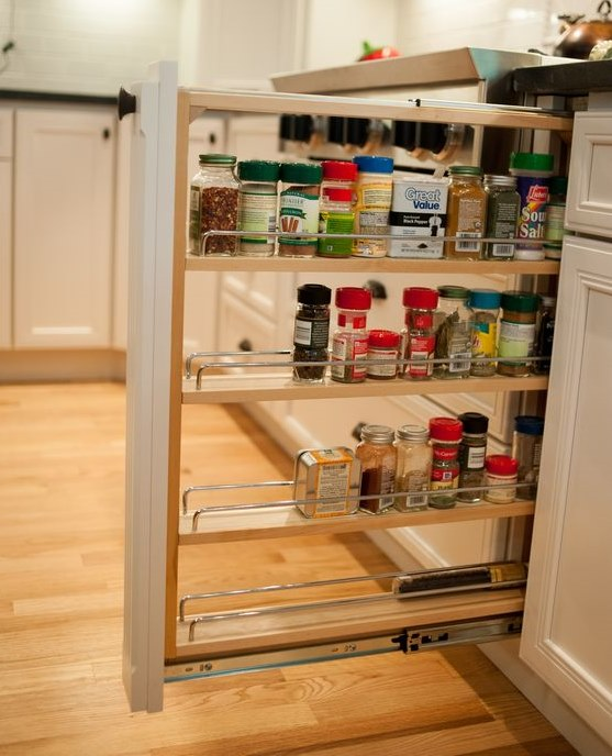 Spice rack pull-out in kitchen